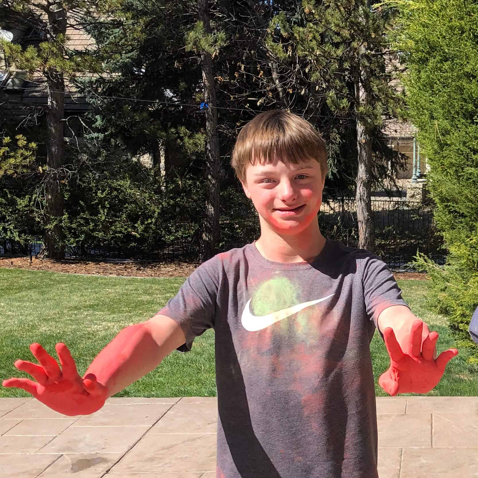 the real Guion (a young boy) with red chalk on his hands