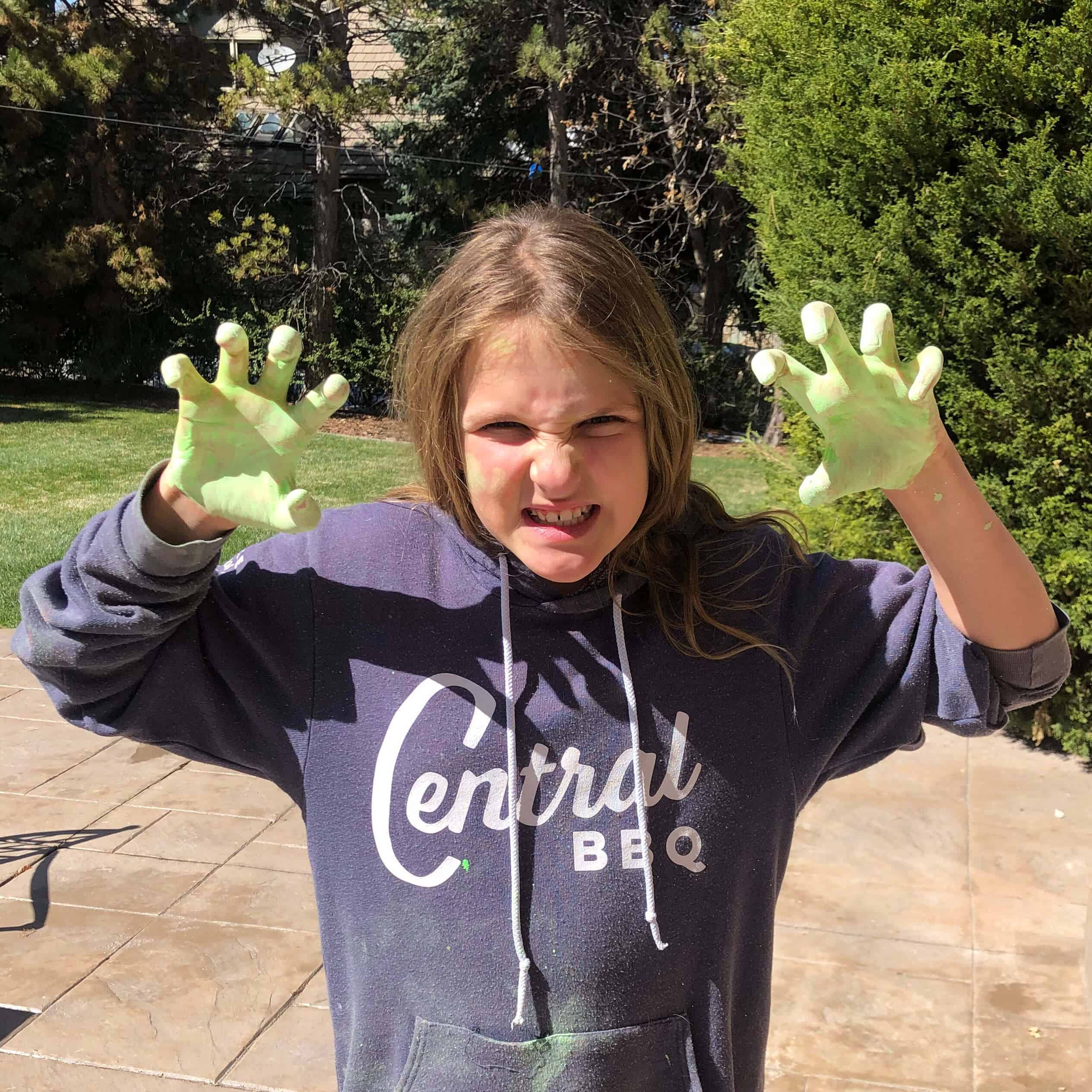 The real Rae (a young girl) with green chalk on her hands